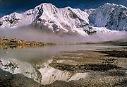 Baruntse 7129 metres (far right), base camp reflection, Barun Makalu National Park, Nepal Himalaya