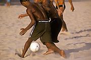 Playing football on Copacabana beach, Rio de Janeiro, Brazil.