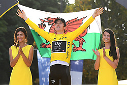 July 29, 2018 - Paris, FRANCE - British Geraint Thomas of Team Sky wearing the yellow jersey of overall leader and holding a Welsh flag celebrates on the podium after the last stage of the 105th edition of the Tour de France cycling race, 116km from Houilles to Paris, France, Sunday 29 July 2018. This year's Tour de France takes place from July 7th to July 29th. BELGA PHOTO DAVID STOCKMAN (Credit Image: © David Stockman/Belga via ZUMA Press)