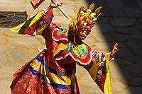 Masked dancers performing the Dance of the Terrifying Deities at the Paro Tsechu (Festival), Paro, Bhutan