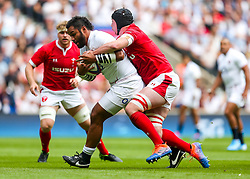 Billy Vunipola of England is tackled by Adam Beard of Wales - Rogan/JMP - 11/08/2019 - RUGBY UNION - Twickenham Stadium - London, England - England v Wales - Quilter Series.
