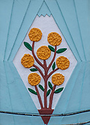 Colourful plaster floral design with a light blue background Photographed as a wall decoration in Nazare, Portugal