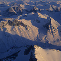 BAFFIN ISLAND, NUNAVUT, CANADA. Sunset on wilderness mountains near Clyde River hamlet, north of Arctic Circle.
