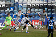 An early shot  from Stephen Humphrys of Rochdale is cleared off the line during the EFL Sky Bet League 1 match between Rochdale and Burton Albion at the Crown Oil Arena, Rochdale, England on 27 February 2021.