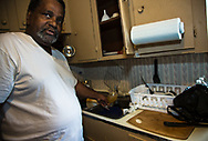 St. Joseph, Louisiana, resident Lee Richardson gets discolored water from his tap. in his kitchen.  Gov. John Bell Edwards made an emergency health proclamation on December 16, 2016, enabling a fast-tracked replacement of St. Joseph's water system after lead was found in the water.