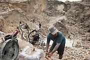 Illegal tin mine in Batako, Tunghin. Bangka Island (Indonesia) is devastated by illegal tin mines. The demand for tin has increased due to its use in smart phones and tablets.<br /> <br /> <br /> Mine d'étain illégale à Batako - Tunghin. <br /> L'île de Bangka (Indonésie) est dévastée par des mines d'étain sauvages. la demande de l'étain a explosé à cause de son utilisation dans les smartphones et tablettes.