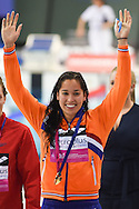 Ranomi Kromowidjojo of the Netherlands celebrates the gold medal as she passes her team area on day 14 of the 33rd  LEN European Aquatics Championship Swimming Finals 2016 at the London Aquatics Centre, London, United Kingdom on 22nd May 2016. Photo by Martin Cole.