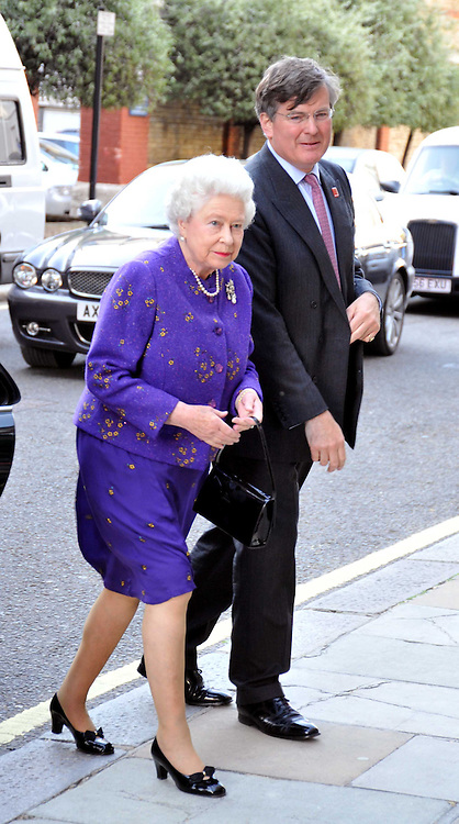 HM THE QUEEN arriving and CAPT.ASHE WINDHAM Chairman of the Friends of The Castle of Mey at a reception for the Castle of Mey held at the Goring Hotel, London on 19th May 2009.