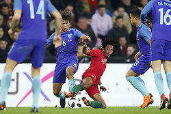 (L-R) Nathan Ake of Holland, Gelson Martins of Portugal during the International friendly match match between Portugal and The Netherlands at Stade de Genève on March 26, 2018 in Geneva, Switzerland