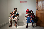 Women wait with their children to be seen at an obstetrics clinic run by Haitian NGO FONDEPH in Port-au-Prince, Haiti, during a visit by a UNICEF delegation.