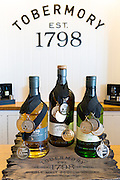 Medal winning Scotch single malt whisky, Ledaig and Tobermory at Tobermory Distillery on the Isle of Mull in the Highlands of Scotland