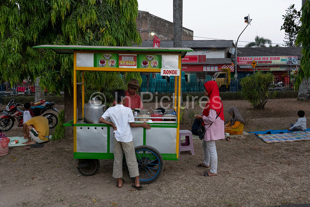 A man selling traditional Indonesian street food from his cart in Borobudur on the 25th October 2019 in Java in Indonesia.