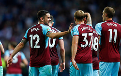 Burnley's Robbie Brady (left) celebrates his goal during the Carabao Cup, Second Round match at Ewood Park, Blackburn.