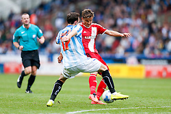 Jelle Vossen of Middlesbrough is challenged by Jack Robinson of Huddersfield - Photo mandatory by-line: Rogan Thomson/JMP - 07966 386802 - 13/09/2014 - SPORT - FOOTBALL - Huddersfield, England - The John Smith's Stadium - Huddersfield town v Middlesbrough - Sky Bet Championship.