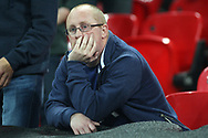 A dejected Spurs fan at the final whistle after seeing his team lose 2-3 after leading the match 2-0.  EFL Carabao Cup, 4th round match, Tottenham Hotspur v West Ham United at Wembley Stadium in London on Wednesday 25th October 2017.<br /> pic by Steffan Bowen, Andrew Orchard sports photography.
