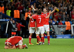 Gareth Bale, Joe Allen, Neil Taylor and Ben Davies of Wales celebrate on the final whistle of the game  - Mandatory by-line: Joe Meredith/JMP - 01/07/2016 - FOOTBALL - Stade Pierre Mauroy - Lille, France - Wales v Belgium - UEFA European Championship quarter final