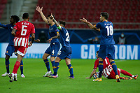 PIRAEUS, GREECE - DECEMBER 09: Players of FC Porto complain to the referee during the UEFA Champions League Group C stage match between Olympiacos FC and FC Porto at Karaiskakis Stadium on December 9, 2020 in Piraeus, Greece. (Photo by MB Media)