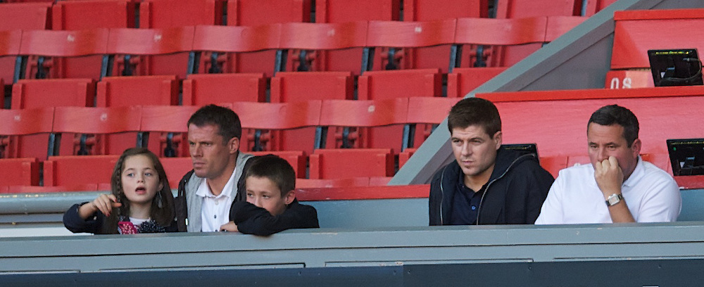 LIVERPOOL, ENGLAND - Wednesday, August 17, 2011: Liverpool's Jamie Carragher and Stephen Gerrard watch their team's U19's in action against Sporting Clube de Portugal during the first NextGen Series Group 2 match at Anfield. (Pic by David Rawcliffe/Propaganda)