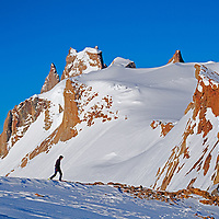 A mountaineer hikes below the Troll's Castle, Filchner Mountains, Queen Maud Land.