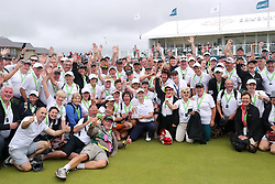 Scotland's Russell Knox poses for a picture with the trophy and course marshals during day four of the Dubai Duty Free Irish Open at Ballyliffin Golf Club.