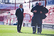 Gareth Ainsworth  of Wycombe Wanderers (Manager) smiles as a colleague is hugged by Adebayo Akinfenwa of Wycombe Wanderers (20) during the EFL Sky Bet League 1 match between Barnsley and Wycombe Wanderers at Oakwell, Barnsley, England on 16 February 2019.