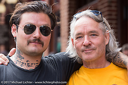 Franky and Christian on Main Street in Deadwood during the annual Sturgis Black Hills Motorcycle Rally. Deadwood, SD, USA. Monday August 7, 2017.  Photography ©2017 Michael Lichter.