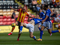 31JUL21 Partick Thistle's Zak Rudden and Queen of the South's Paul McKay. Partick Thistle 3 v 2 Queen of the South. First Scottish Championship game of the season.