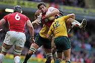 Andrew Bishop of Wales is tackled by Matt Giteau of Australia. Invesco Perpetual series, autumn international, Wales v Australia at the Millennium Stadium in Cardiff on Sat 6th Nov 2010.  pic by Andrew Orchard, Andrew Orchard sports photography,