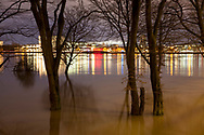 flood of the river Rhine on February 4th. 2021, the flooded meadow in the district Poll, trees in water, Cologne, Germany.<br /> <br /> Hochwasser des Rhein am 4. Februar 2021, die ueberfluteten Rheinwiesen in Poll, Baeume stehen im Wasser, Koeln, Deutschland.
