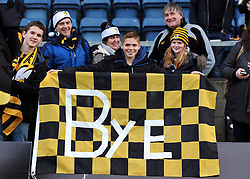 A supporter poses with a flag on the occasion of Wasps' final game at Adams Park - Photo mandatory by-line: Patrick Khachfe/JMP - Mobile: 07966 386802 14/12/2014 - SPORT - RUGBY UNION - High Wycombe - Adams Park - Wasps v Castres Olympique - European Rugby Champions Cup