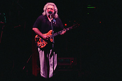 "Jerry Garcia performing with The Grateful Dead Live at The Hampton Coliseum on 9 October 1989. One of the Eleven images included in the CD boxed set release, ""Formerly The Warlocks"". Image capture during ""Dark Star"". Can be purchased individually or as part of a special limited set of all 11 in the package printed by the photographer. Choose in Cart."