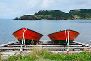 Red rowing boat in the inner Harbour near Corner Brook, Newfoundland, Canada