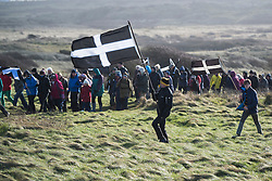 © Licensed to London News Pictures. 05/03/2017. PERRANPORTH, CORNWALL, UK.  Windy day on the dunes. St. Piran's Day in Cornwall. St Piran is the patron Saint of Sinners in Cornwall and it is his flag that is recognised as the Cornish flag. Today his arrival from Ireland to Cornwall is celebrated across Cornwall especially in Perranporth where it is believed that he landed. He set up an Oratory and a Church the remains of which have been recently uncovered in the sand dunes at Perranporth..  Photo credit: MARK HEMSWORTH/LNP