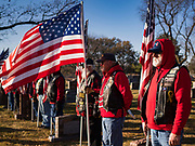 22 NOVEMBER 2019 - DES MOINES, IOWA: Members of the Patriot Guard Riders stand at attention during the reinterment of Marine Corps Reserve Private Channing Whitaker at the Glendale Cemetery. Whitaker died in the Battle of Tarawa on Nov. 22, 1943 during World War Two. He was buried on Betio Island, in the Gilbert Islands, and his remains were recovered in March 2019. He was identified by a DNA match with surviving family members in Iowa. Whitaker was reintered in the Glendale Cemetery in Des Moines exactly 76 years after his death in World War Two. About 1,000 US Marines and sailers were killed in four days during the Battle of Tarawa.            PHOTO BY JACK KURTZ