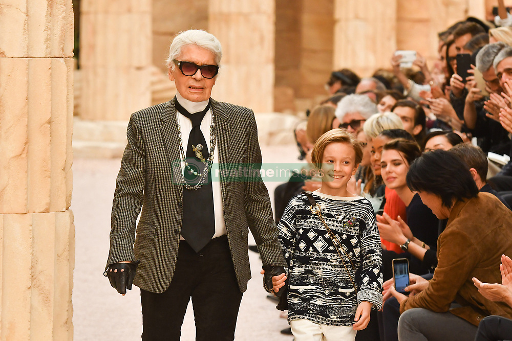 File photo - Designer Karl Lagerfeld and nephew Hudson Kroenig walk the runway during Chanel Cruise 2017/2018 Collection at Grand Palais on May 3, 2017 in Paris, France. Karl Lagerfeld died on Monday at age 85. One who may inherit is his godson Hudson. Hudson's dad, model Brad Kroenig, is like 'family' to Lagerfeld. Hudson began modeling for Chanel at age two and had continued to pop up on the runway ever since. Photo by Laurent Zabulon/ABACAPRESS.COM