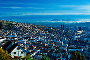 The view from El Panecillo of the city of Quito, Ecuador, which sits at an elevation of almost 10,000 feet and appears to rise above the clouds and Andes Mountains.  The colonial section of the city has been declared a UNESCO World Heritage Cultural Site.