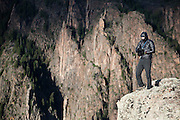 Obadiah Reid stands on the canyon rim at Island Peaks, Black Canyon of the Gunnison National Park, Colorado.