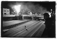 Palm trees are set ablaze next to an empty 101 freeway in downtown. 4/29/1992