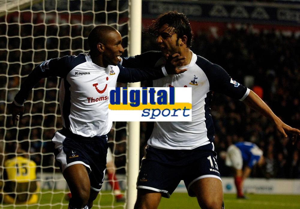 Photo: Daniel Hambury.<br />Tottenham Hotspur v Portsmouth. The Barclays Premiership. 12/12/2005.<br />Tottenham's Jermain Defoe celebrates scoring the third goal with second goal scorer Mido.