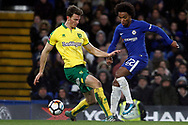 Willian of Chelsea (R) in action with Christoph Zimmermann of Norwich City (L). The Emirates FA Cup, 3rd round replay match, Chelsea v Norwich City at Stamford Bridge in London on Wednesday 17th January 2018.<br /> pic by Steffan Bowen, Andrew Orchard sports photography.