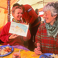 Anne Kershaw and Fran Orlo admire a birthday card painted by Conrad Anker (not shown) in the dinning tent at Adventure Network's Patriot Hills expediton base.