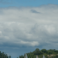 Sailboats tack back and forth in a regatta on Lake of the Woods, near Kenora, Ontario, Canada.