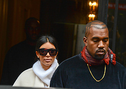 """File photo of Kim Kardashian and Kanye West are spotted leaving Balmain Office and Kim arriving at Hotel Royal Monceau in Paris, France on September 24, 2014. Kim Kardashian West spoke out about Kanye West's bipolar disorder Wednesday, three days after the rapper delivered a lengthy monologue at a campaign event touching on topics from abortion to Harriet Tubman, and after he said he has been trying to divorce her.Kardashian West said in a statement posted in an Instagram Story that she has never spoken publicly about how West's bipolar disorder has affected their family because she is very protective of their children and her husband's """"right to privacy when it comes to his health."""" Photo by ABACAPRESS.COM"""