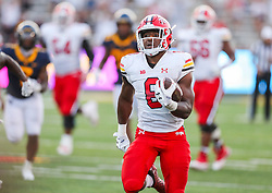 Sep 4, 2021; College Park, Maryland, USA; Maryland Terrapins running back Tayon Fleet-Davis (8) runs for extra yards during the fourth quarter against the West Virginia Mountaineers at Capital One Field at Maryland Stadium. Mandatory Credit: Ben Queen-USA TODAY Sports