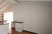 White wall with small furniture to support objects. Copy-space