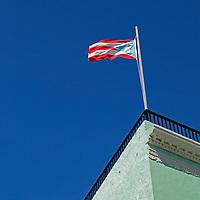 USA, Puerto Rico, San Juan. Flag of Puerto Rico atop building.