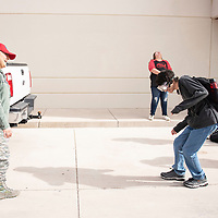 U.S. Air Force Tech Sgt. Tellez, left, with the Joint Counter Drug Task Force watches Micheal Tafoya, 17, attempt to walk a straight line wearing Fatal Vision Alcohol Impairment Simulation Goggles as part of a drug awareness event Wednesday, Feb. 27 at Grants High School.