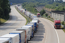 © Licensed to London News Pictures. 30/07/2015 <br /> Lorries stacked up between J8 and J9 M20 (this afternoon 30.07.2015).coast bound.<br /> Traffic misery continues on the M20 with Operation Stack and will most likely remain in place into the weekend.<br /> A 23-mile stretch of the coast-bound carriageway is shut with part of the London-bound side also closed.<br /> <br /> <br /> (Byline:Grant Falvey/LNP)