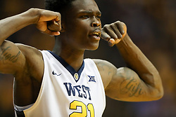 Jan 9, 2018; Morgantown, WV, USA; West Virginia Mountaineers forward Wesley Harris (21) celebrates from the bench during the second half against the Baylor Bears at WVU Coliseum. Mandatory Credit: Ben Queen-USA TODAY Sports