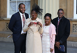 Baroness Amos, with family, after receiving her Member of the Order of the Companions of Honour at Buckingham Palace in London.